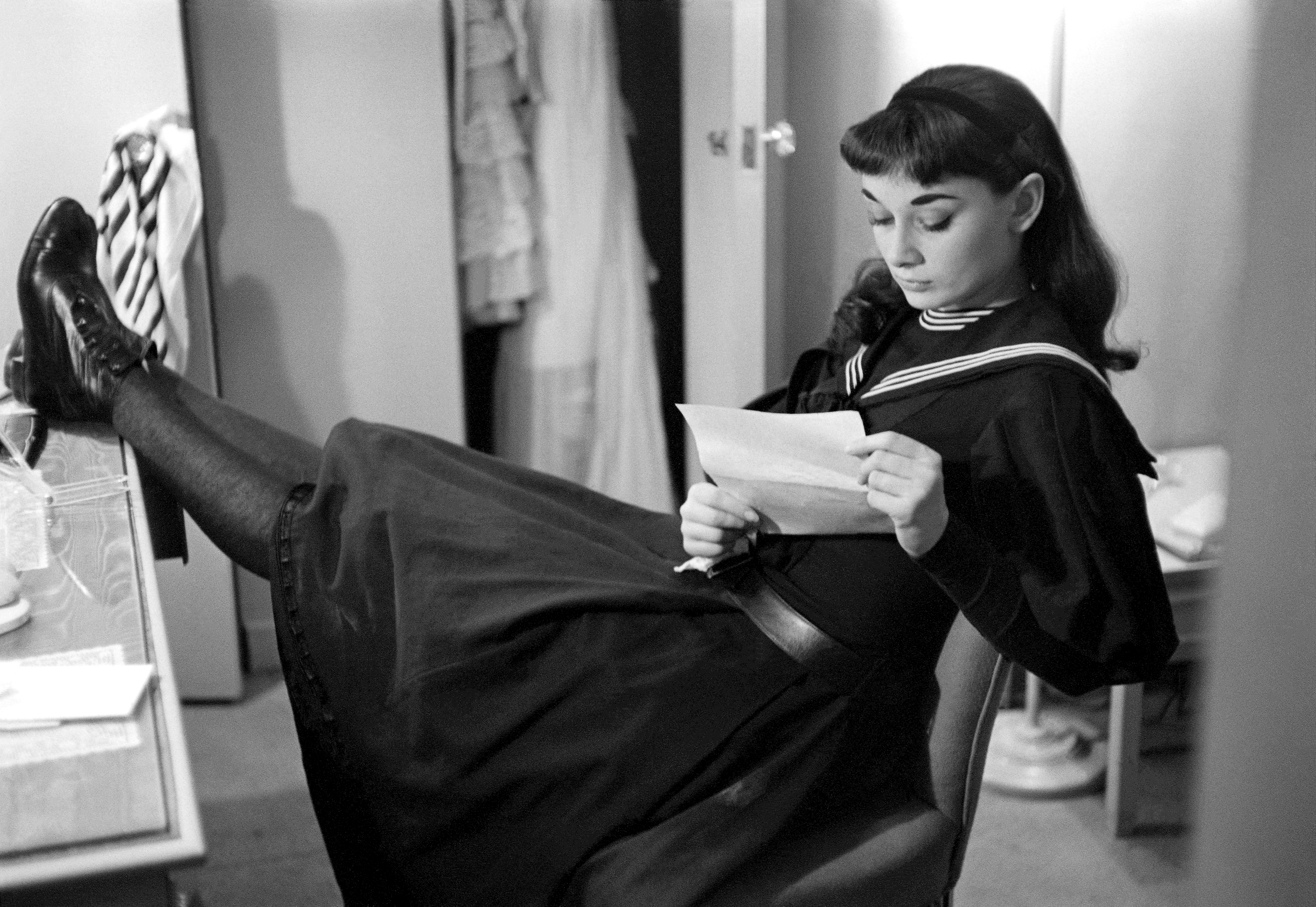 a young Audrey Hepburn reading
