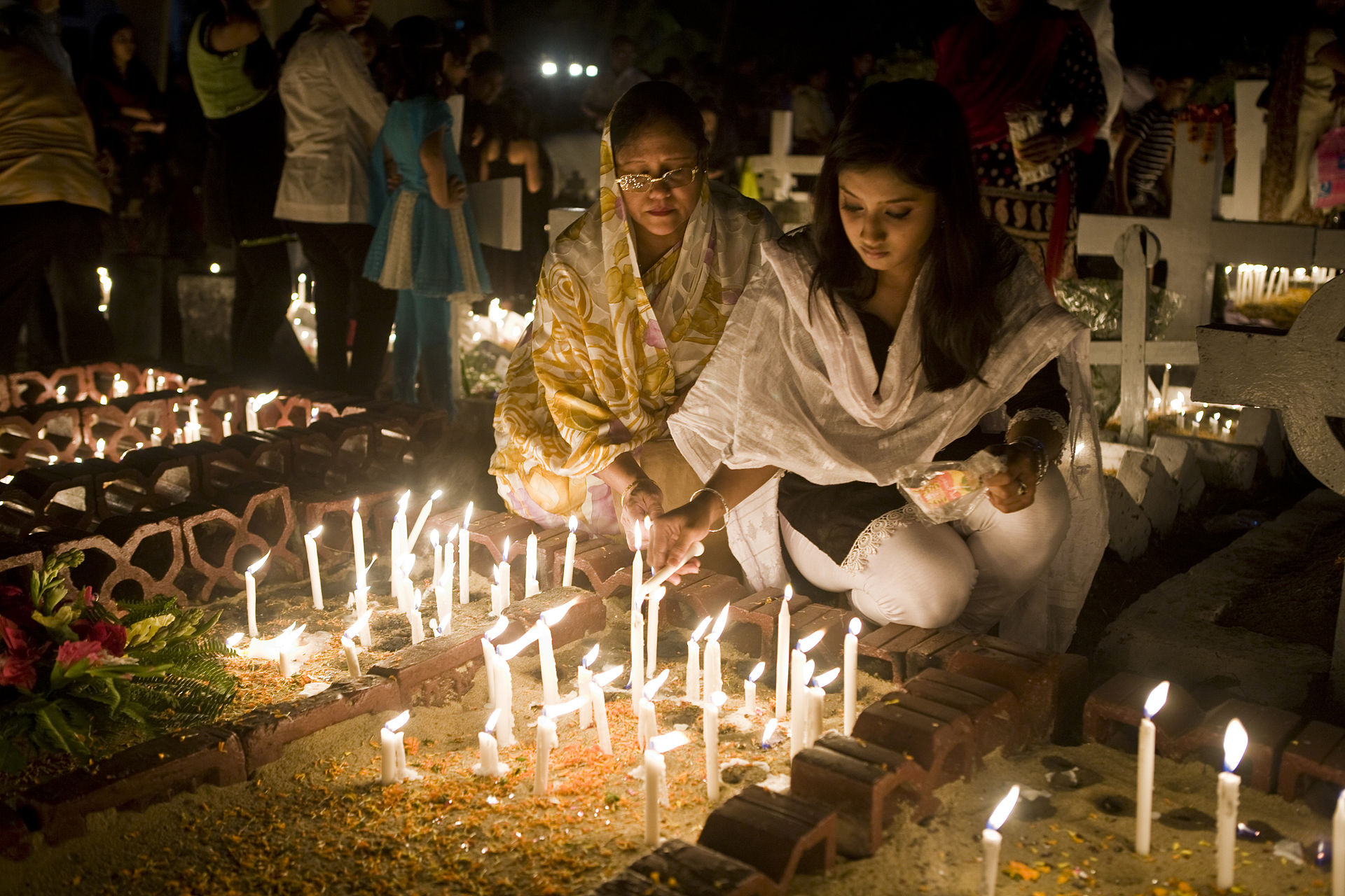 All Hallows Eve in Bangladesh - families lighting candles