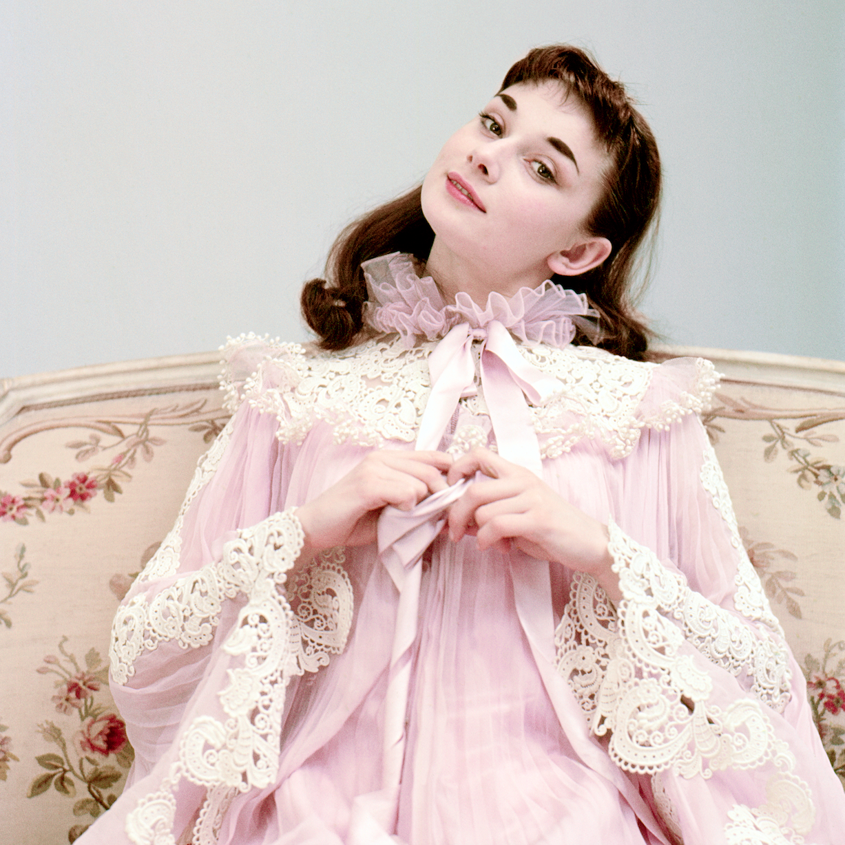 rare photo of young audrey hepburn in pink dress long hair