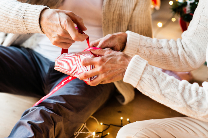 helping dementia patient wrap a christmas present