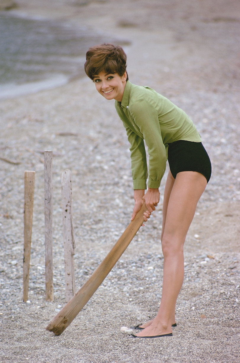 Audrey Hepburn playing cricket on the beach