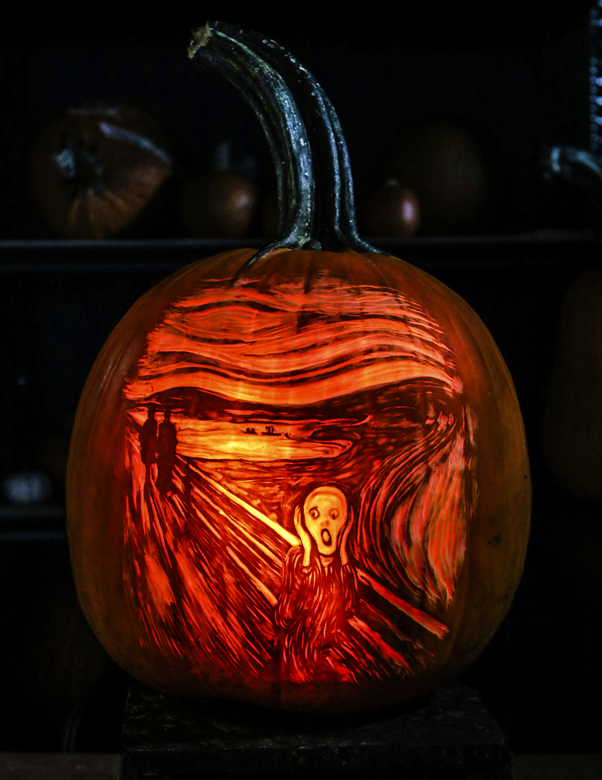 a pumpkin carved in the image of Edvard Munch's The Scream