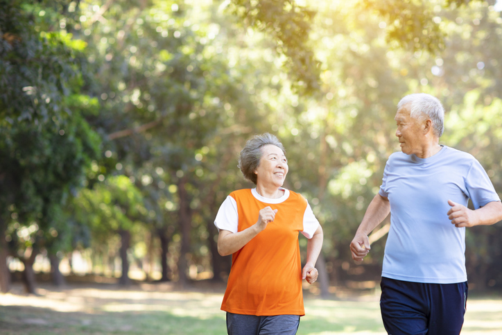 two older people running together to help their hearing