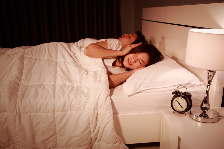 a woman suffering with her partner's snoring