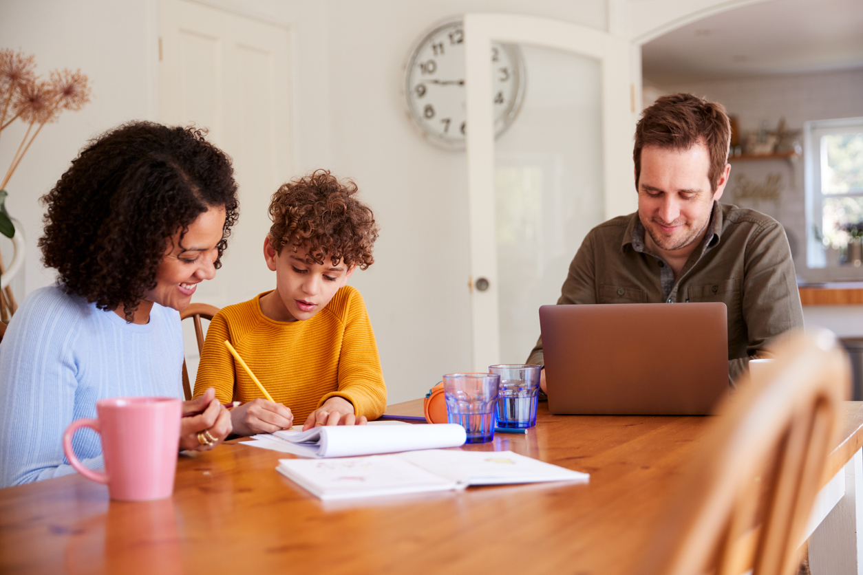 family working from home homeschooling