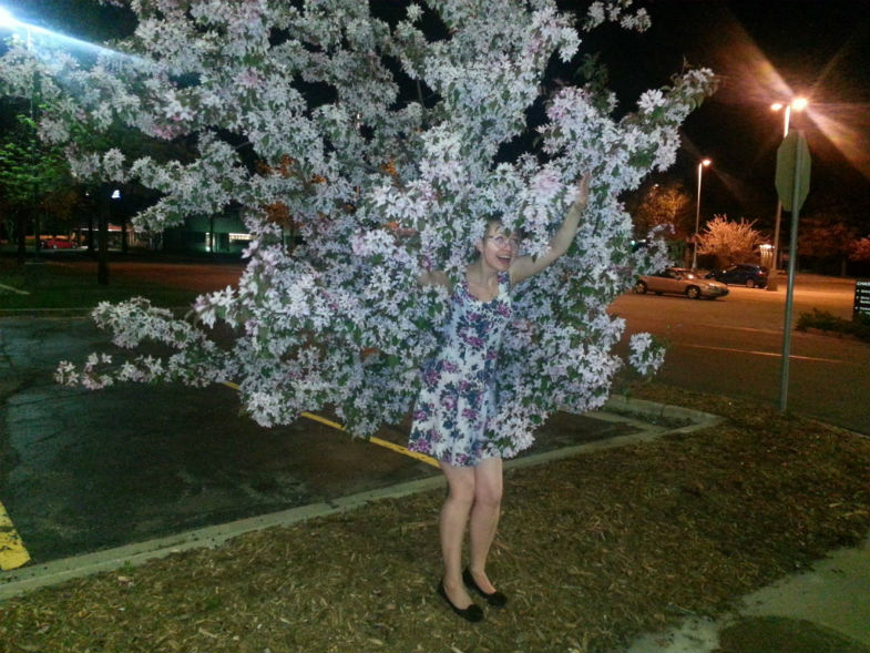 girl blending in with a tree