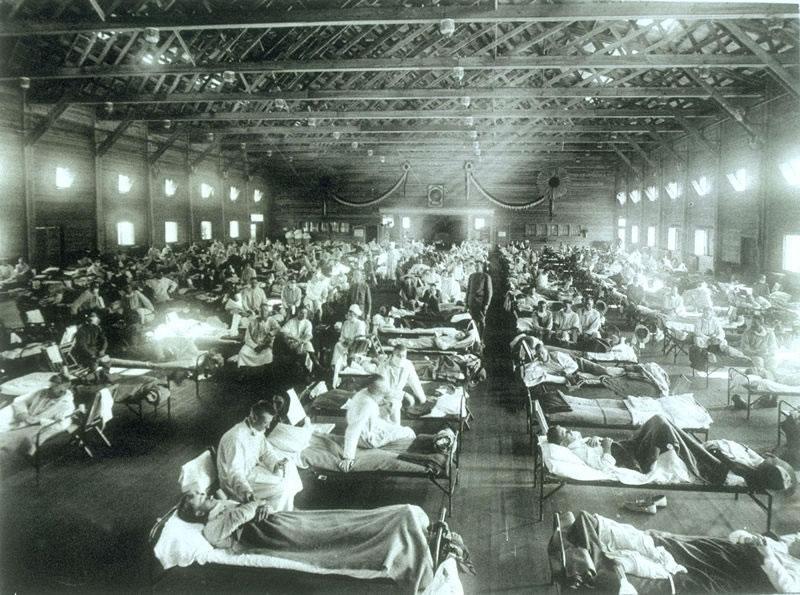 Soldiers from Fort Riley, Kansas, ill with Spanish influenza at a hospital ward at Camp Funston.