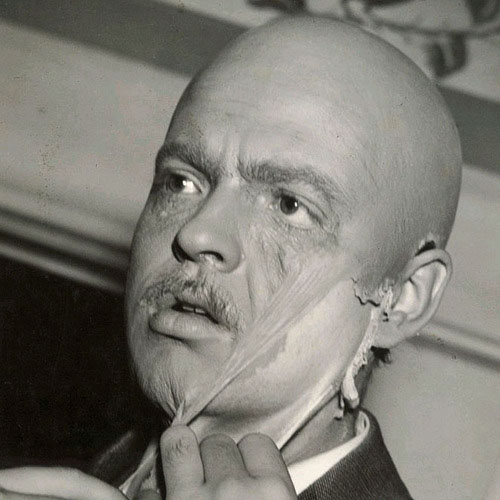 Orson Welles tears off his Citizen Kane make up