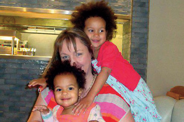 Coping with loss: Louise Smith with daughters Jasmine and India