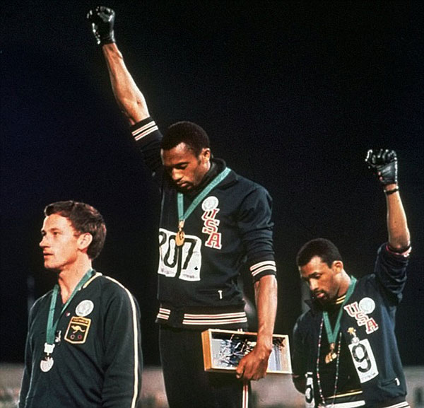 Smith and Carlos give black power salute at 1968 olympics