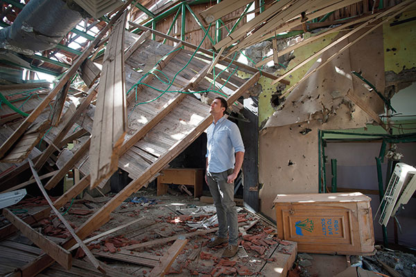 Sam Wood inspects damage to Right to Live's school