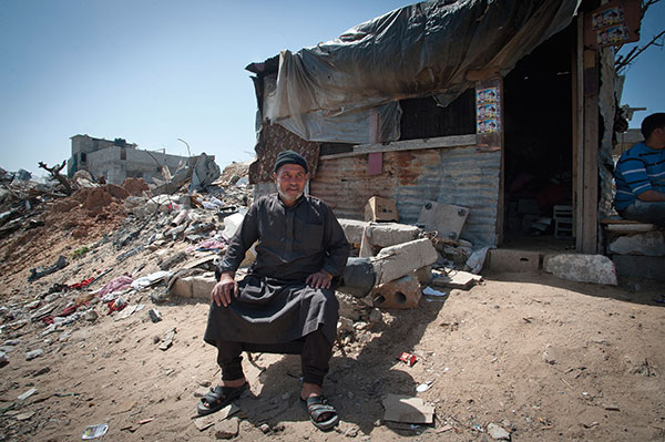 Local Salem Ejah outside  his dilapidated shack in Shujaiya