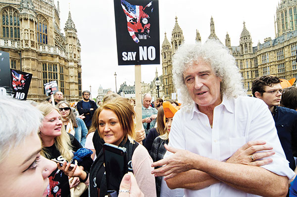 Did brian may complete his thesis
