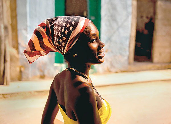 Cuban woman wearing a colourful USA flag headscarf