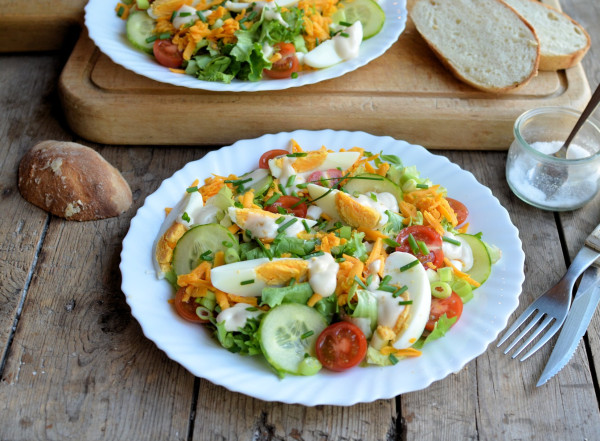 english garden salad with cheese and eggs