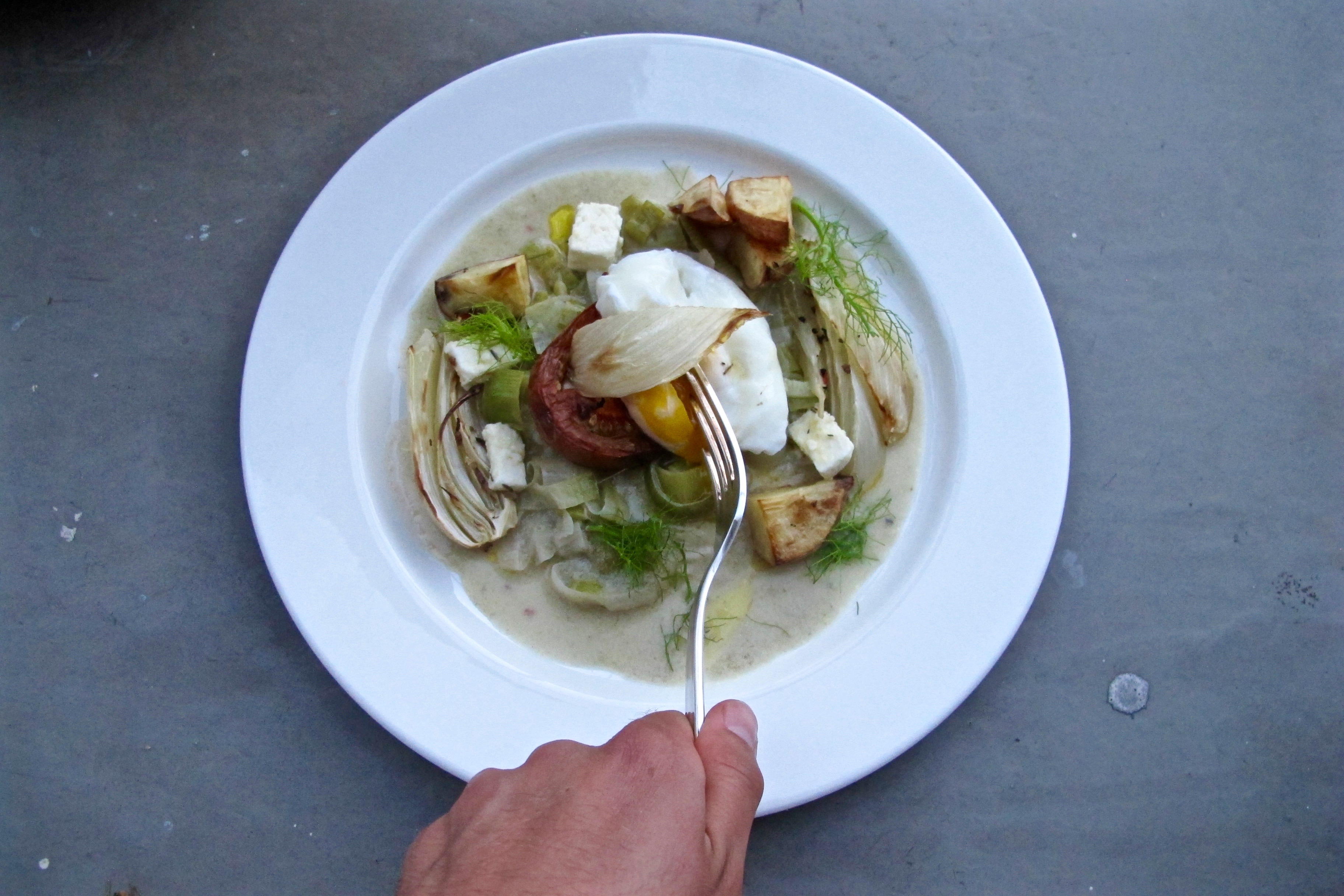 poached egg in cream of artichoke and leek