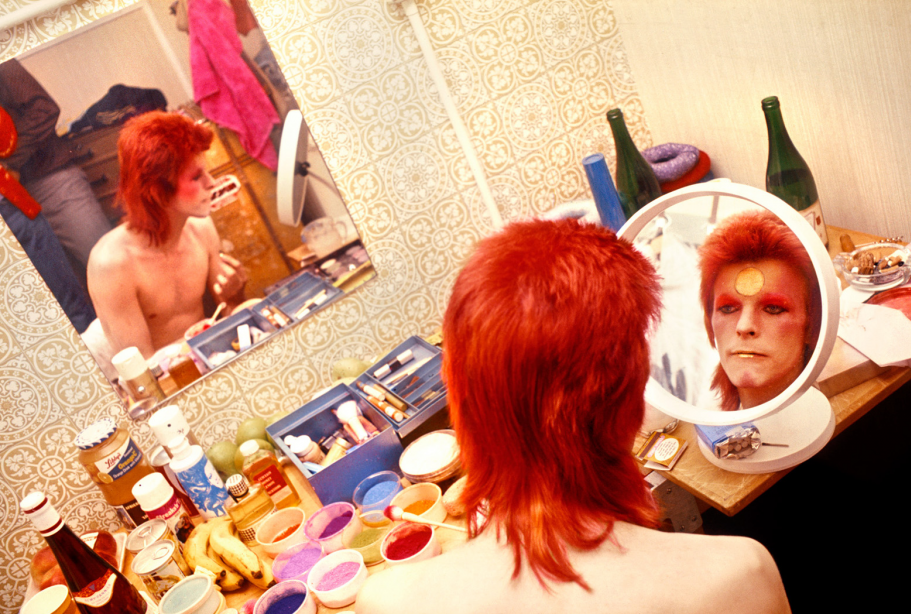 David Bowie applies makeup