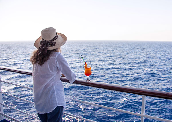 Woman on cruise with cocktail