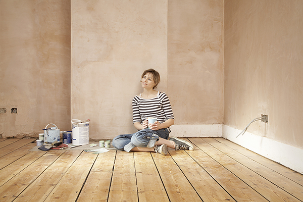 Woman finishing flooring
