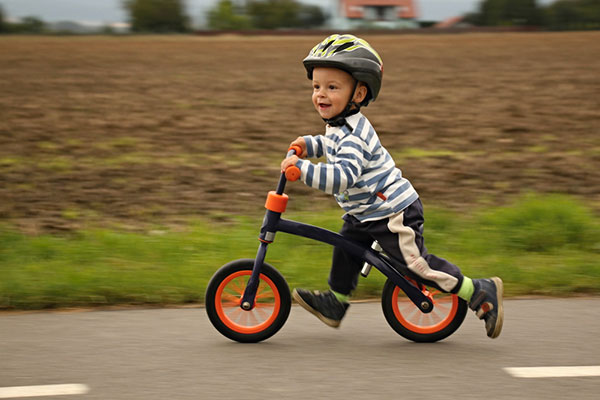 Toddler on balance bike